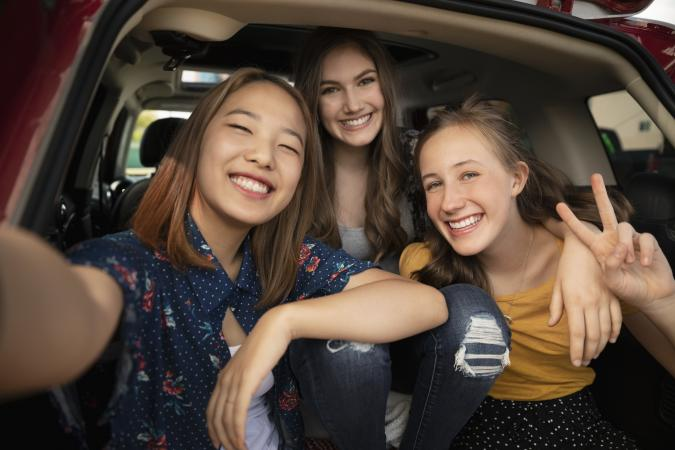 Teen girls taking a selfie