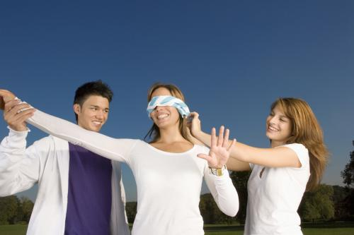 Teens playing blindfold game