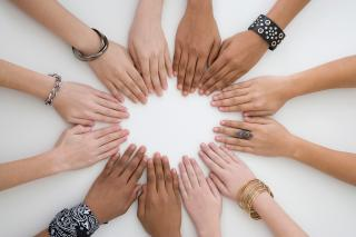 Diverse group of hands in circle
