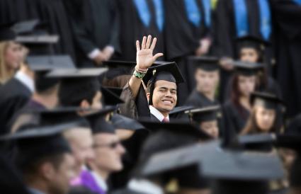High school graduate waving