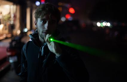 Teen boy holding a laser pointer