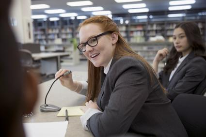 Student in debate club library