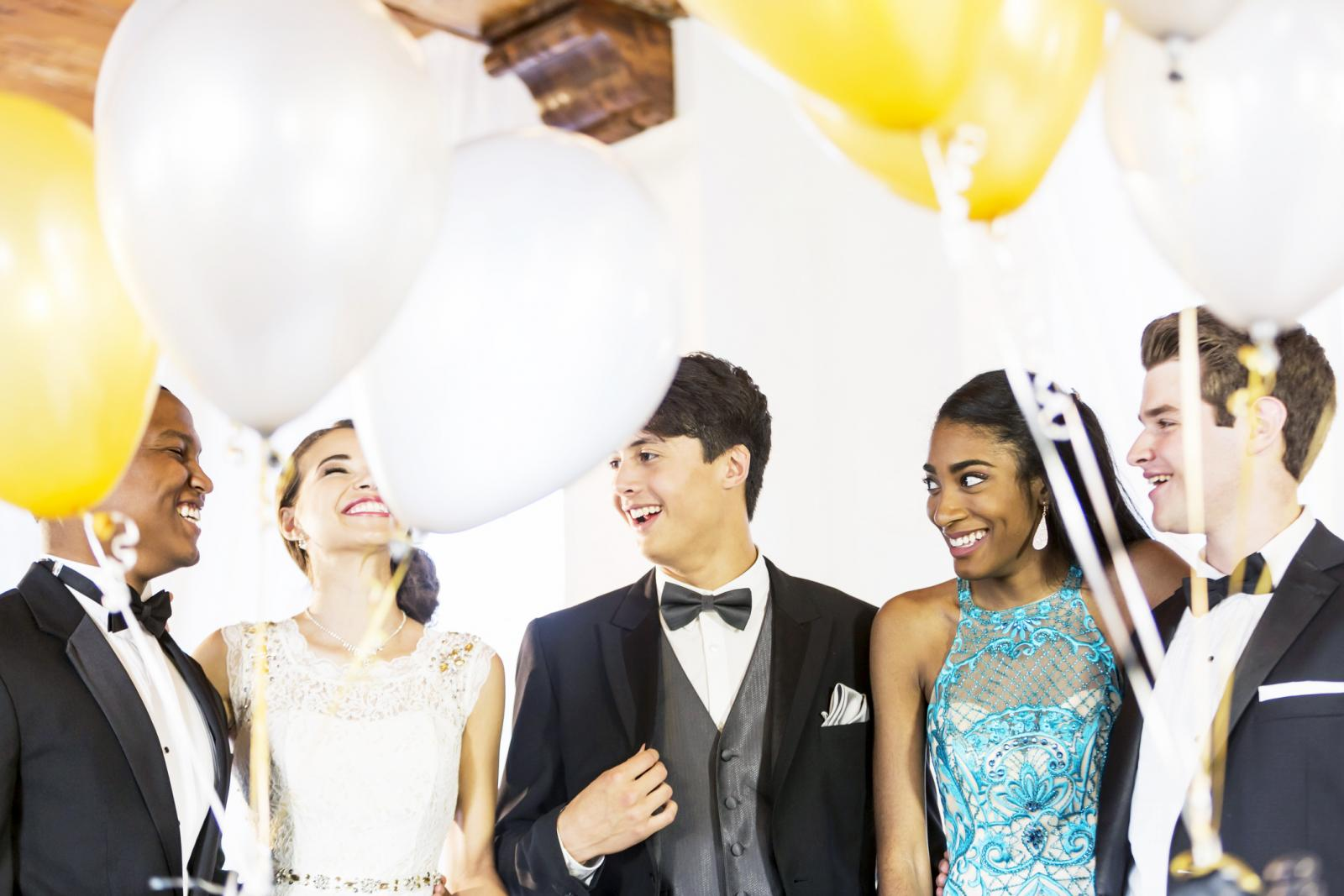 Teenagers in formalwear at party
