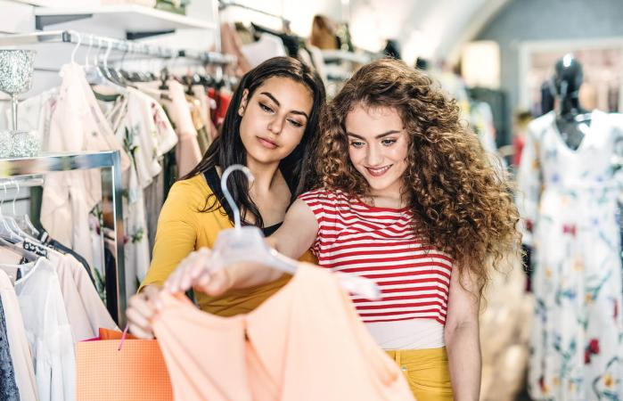 Teen girls shopping for dresses