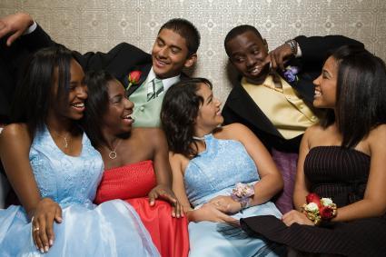 Teens in formal wear enjoying themselves