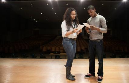 Teens rehearsing onstage