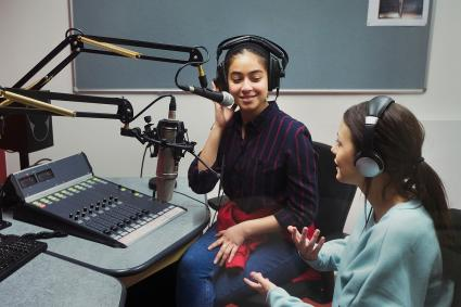 Teen girls recording podcast