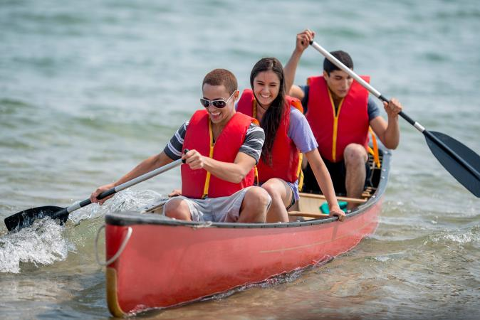 teens in canoe at camp
