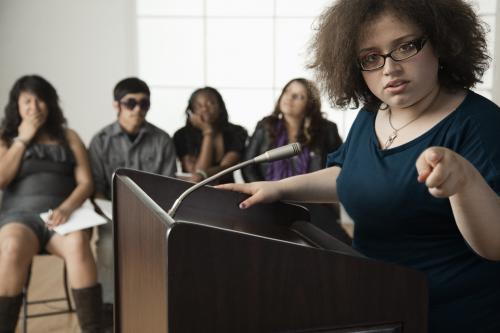 Girl giving speech in debate class