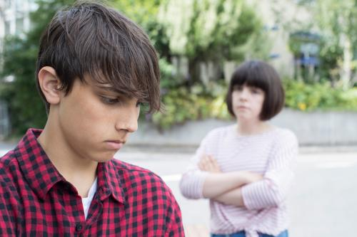 Unhappy young teen couple