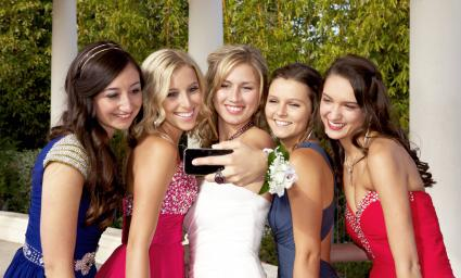 Teenage Prom Girls Taking a Photo with Mobile Phone