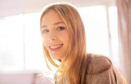 Portrait smiling blonde teenage girl