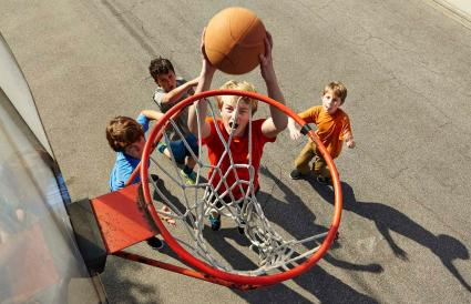 Boys playing basketball