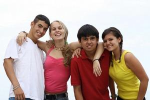 Happy teen members of a youth group