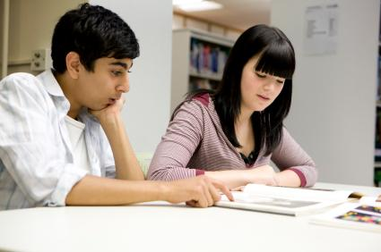 Students reading in a library.