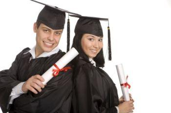 A male and a female graduate with their diplomas