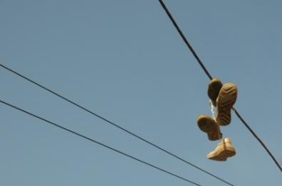 Shoes hanging on a power line to mark gang territory