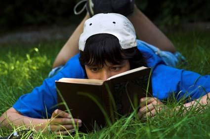 Boy reading poems about growing up