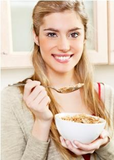 Teen eating cereal