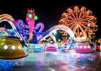 Illuminated amusement park ride at night