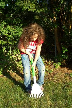 Child gardening with Little Tikes Rake