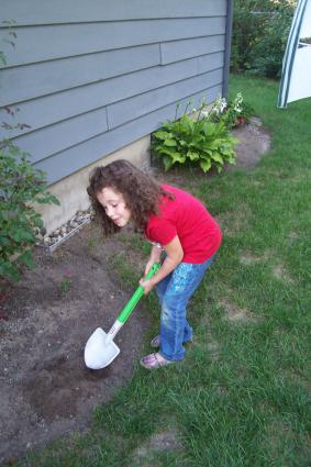 Child gardening with Little Tikes Shovel