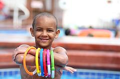 Boy with pool diving toys