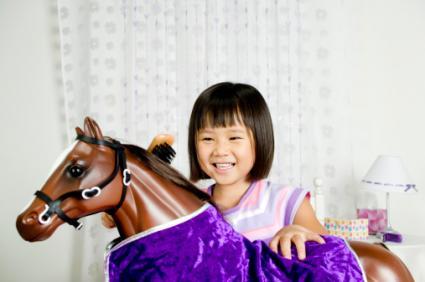 Girl Riding Rocking Horse