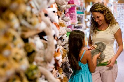 Mother and daughter in toy store