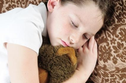 child sleeping with stuffed animal