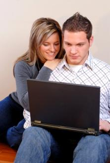 Couple searching online for a romantic getaway