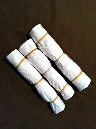 T-shirts rolled up with rubberbands