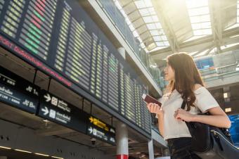 Woman checking flight info at airport
