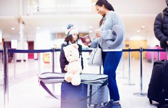 Girl and mother looking at passport