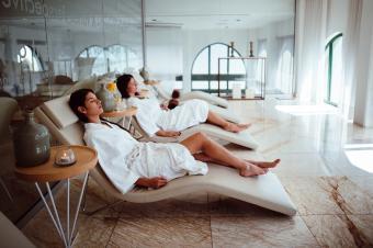 Women having treatments at spa center