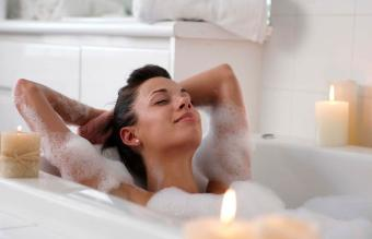 Young woman in bubble bath