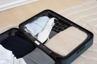 Nori steam iron in a suitcase