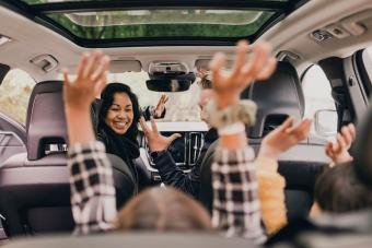 Cheerful family enjoying road trip
