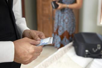 Concierge with tip from woman