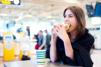 Woman eating at the airport