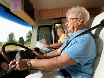 couple driving RV