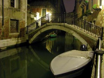 canal with boat in Venice, Italy