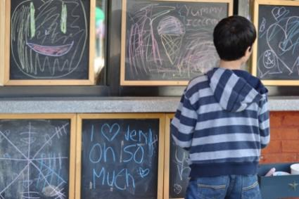 kid on chalkboard