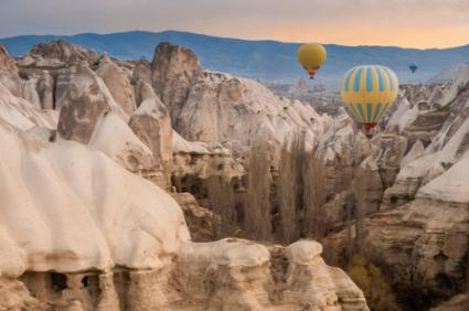 Hot air balloon flying over the landscape of Cappadocia