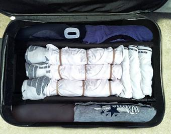 Clothes packed between handles