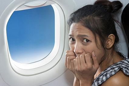 Terrified passenger on airplane