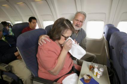 Woman Vomiting on a Plane