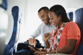 Couple using inflight internet