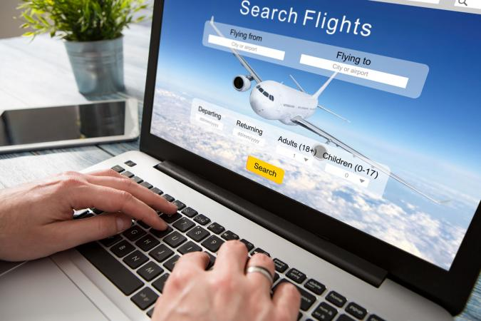 Booking flight travel on computer