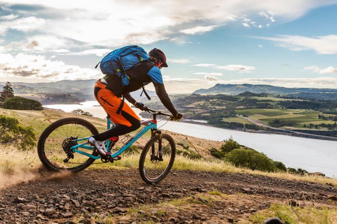 Mountain biker with back pack on ride